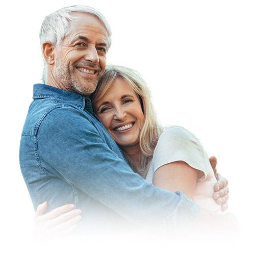 Older couple hugging | Katmai Eye and Vision Center